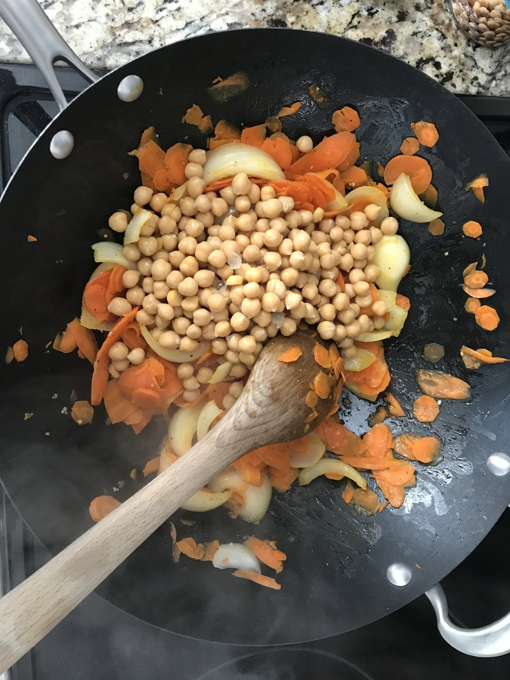 - Saute carrots and onion in large skillet or wok with olive oil until carrots and onion are soft. Add garlic and garbanzo beans and cook another 1-2 minutes. Add parsley, vinegar, salt and pepper. Mix well and serve hot.