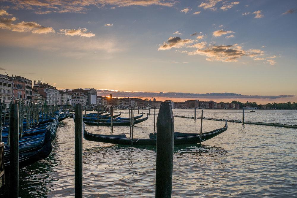 Sun rising over gondolas