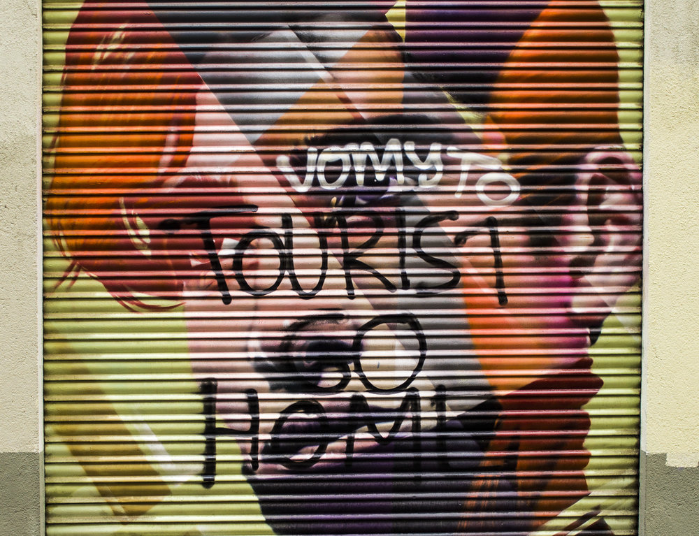 Street art expressing frustration with the 30 million tourists that visit Barcelona annually