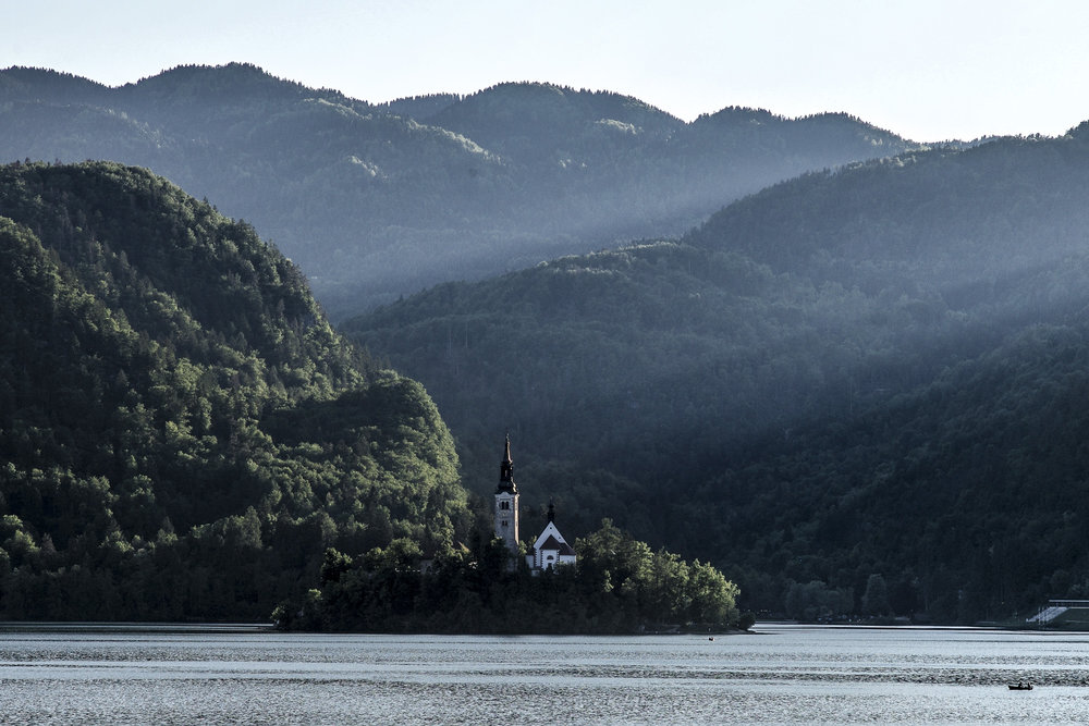 Bled Island with morning sun beams