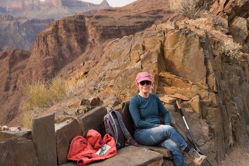 Cheryl on a stone bench