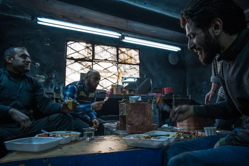 Metal workers enjoying lunch