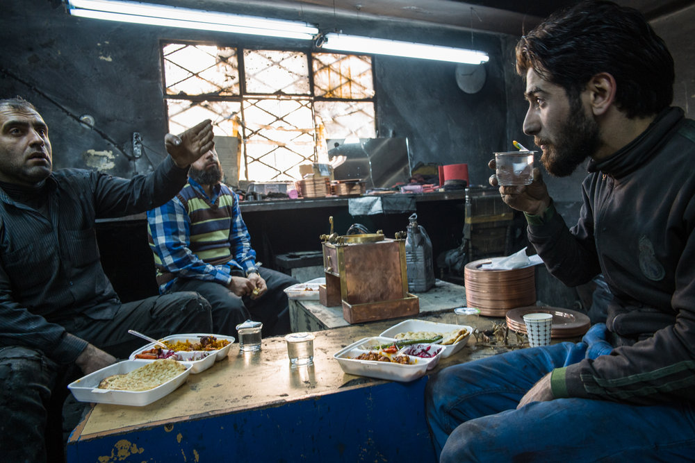 Metal workers enjoying tea after lunch