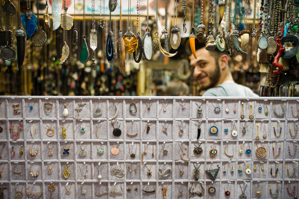 A Grand Bazaar merchant hoping a potential visitor turns into a customer