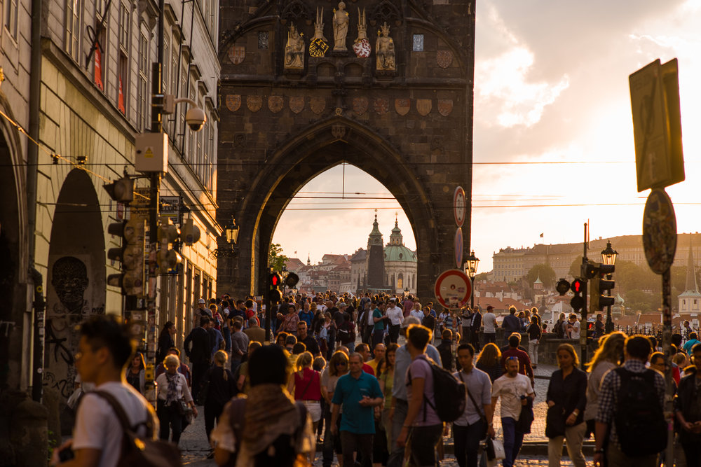 Charles Bridge at dusk. 30 million tourists annually visit Prague so planning is essential.