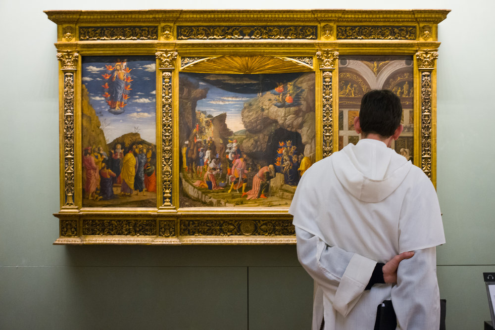 A priest enjoying sacred art at The Uffizi