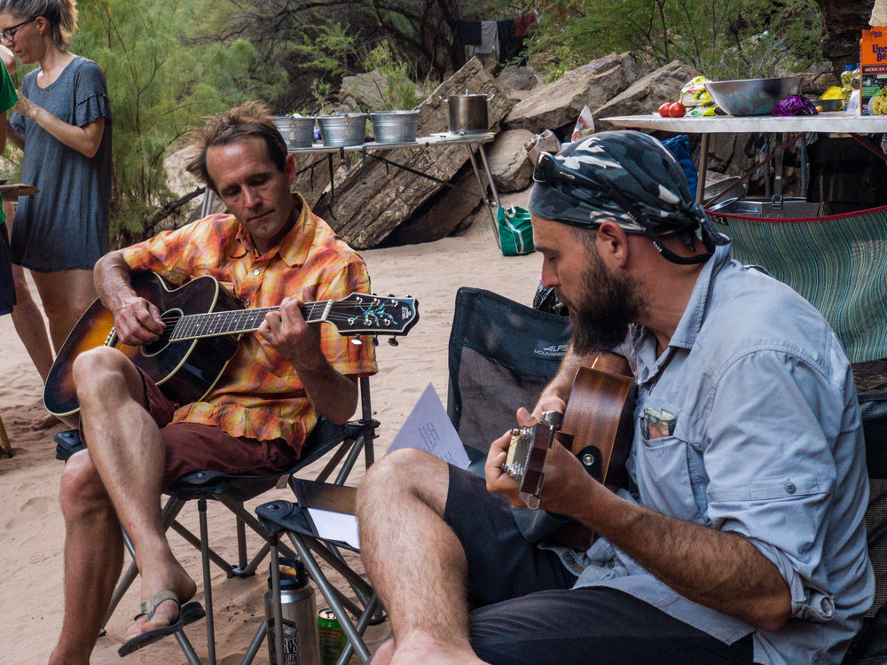 Nathan and Albert playing guitar in camp