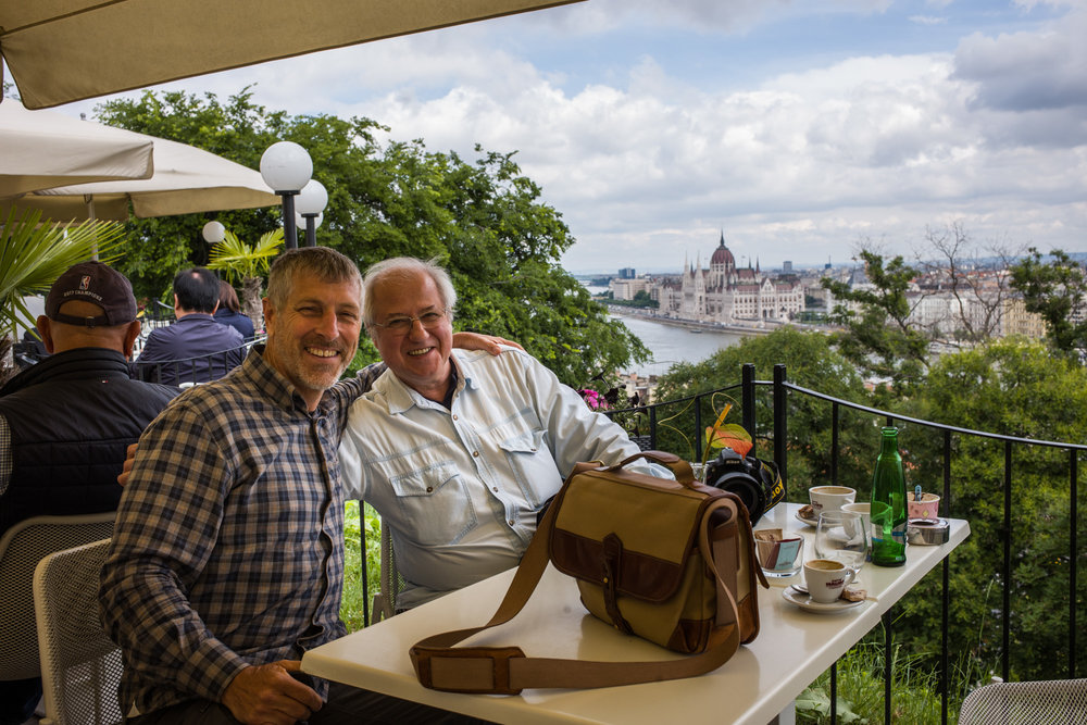 Overlooking the Danube, Tamas and Rick enjoy coffee and conversation