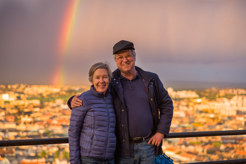 Cheryl and Tamas with the rainbow painting the sky above Budapest