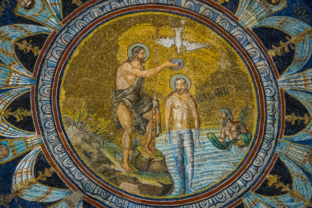 The baptism of Christ at the top of the baptistry