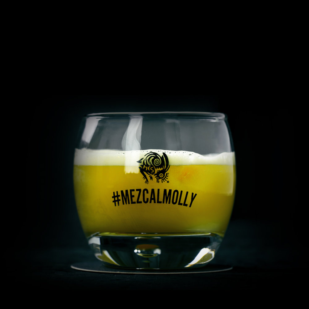 THE MEZCAL MOLLY  INGREDIENTS  - 2 oz. El Silencio Espadin  - .75 oz. Honey Syrup  - .75 oz. Fresh Lime Juice  METHOD  Shake & Strain  Pinch of Chile Salt