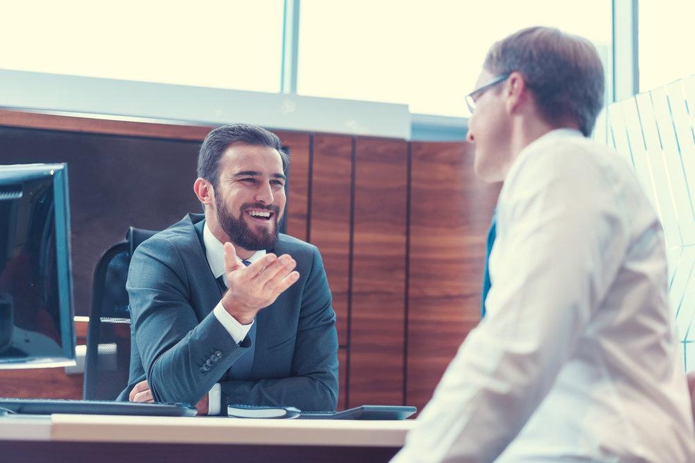 Sales order- two men talking at desk.jpeg
