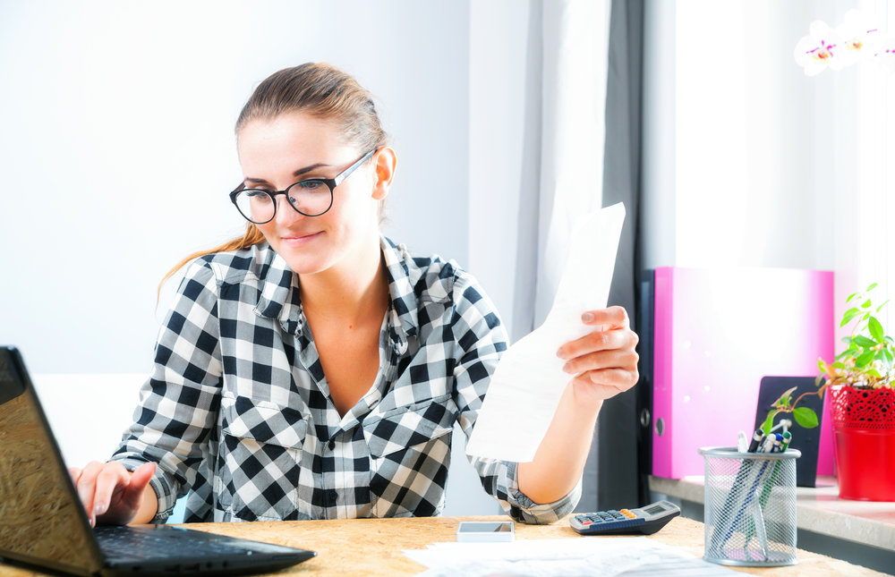 payables - woman on computer with receipt.jpeg