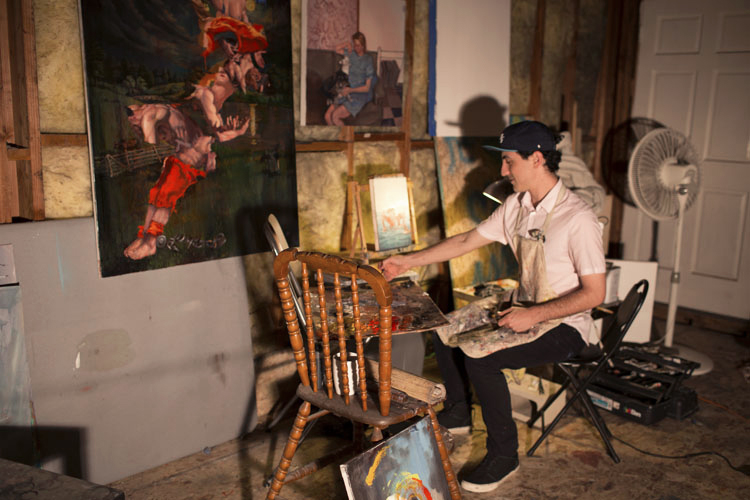 Zach Mendoza in his studio working on pieces for an upcoming solo show in Orange County.