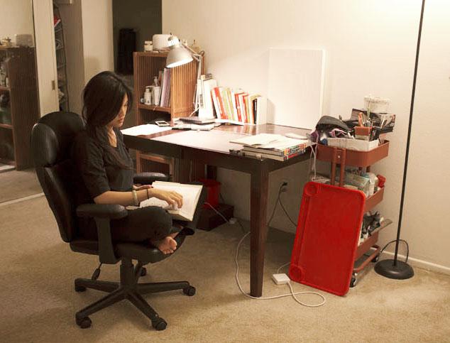 Lily Mendoza researching design at her desk