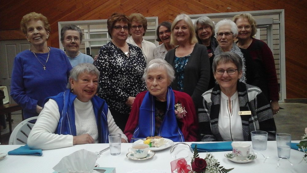 Mary Pattison (centre), celebrating her 100th birthday
