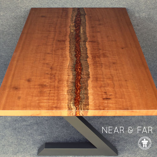 Custom modern slab table with river filled live edge