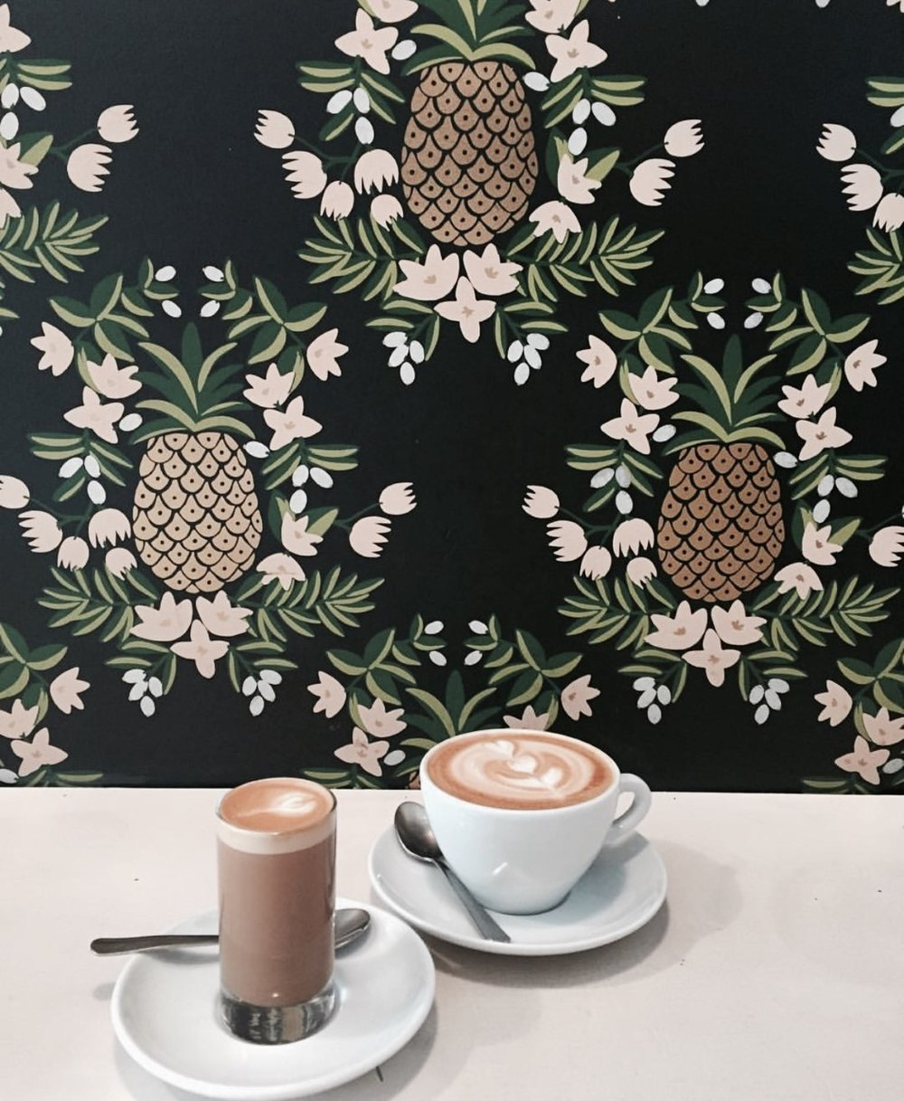 WRECKING BALL  - Ok, so the main thing here is the amazing pineapple wallpaper! I mean, come on that wallpaper and a cup of coffee in front of it has to create a statement Insta photo! I had been dying to go here, since I saw it on Yelp a while back, so when my friend from L.A (also a coffee addict) was visiting, we couldn't wait to catch up & snap away. Even there sugar and milk table had the trendy pineapple background as well as cute sugar cubes on a block of wood (I get really excited about the small details). We also got a photo shoot session outside, as its the perfect place to take a picture of (your outfit, duh) against a white wall & some trendy coffee shop furniture. We managed to get some cool boomerangs there too. Will post on my Instagram soon! Keep a lookout!