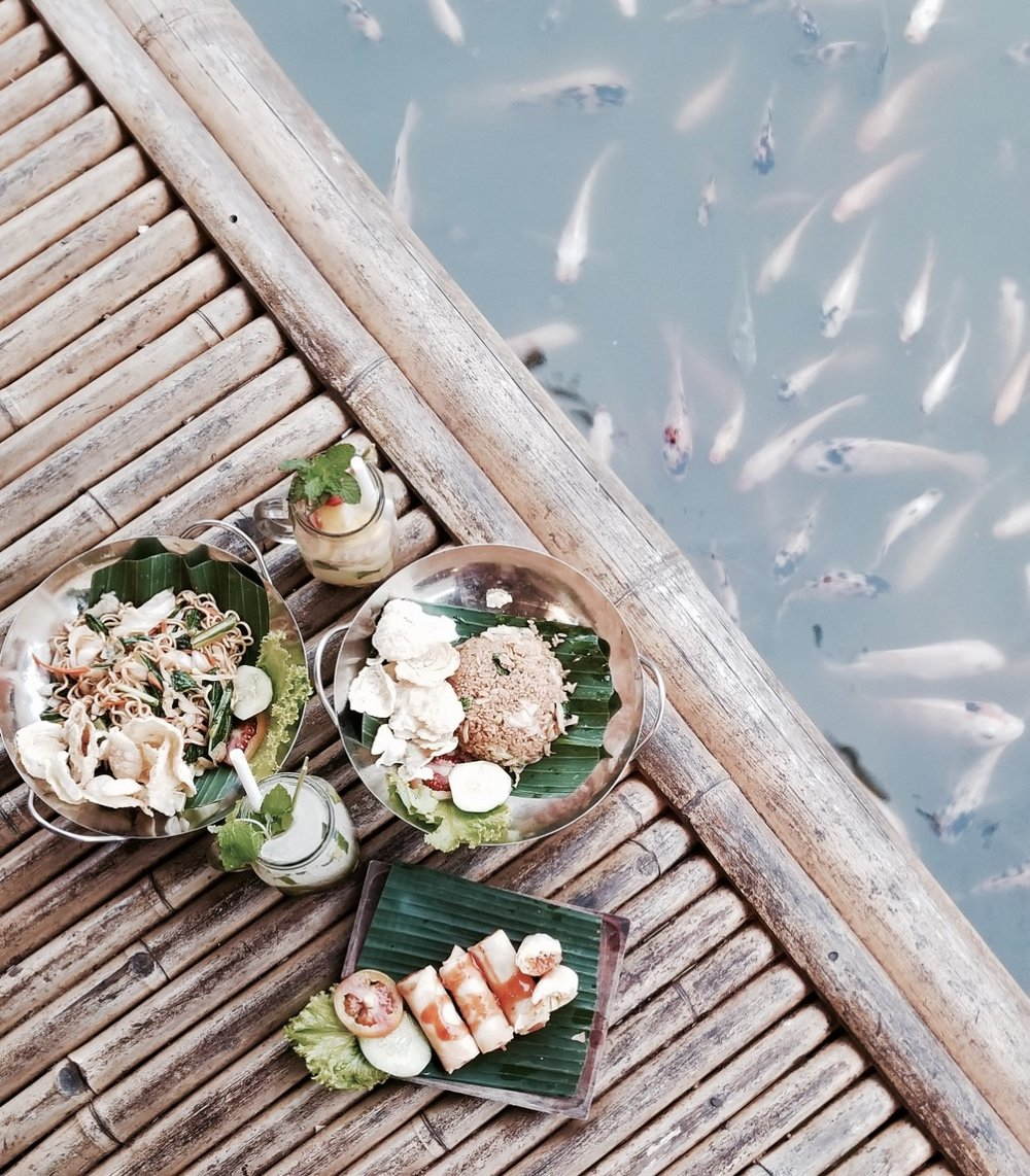 BALE UDANG RESTAURANTS - Private water villa dining with authentic Balinese food where you can feed the fish as you wait in your hut.One of the coolest dining experiences.