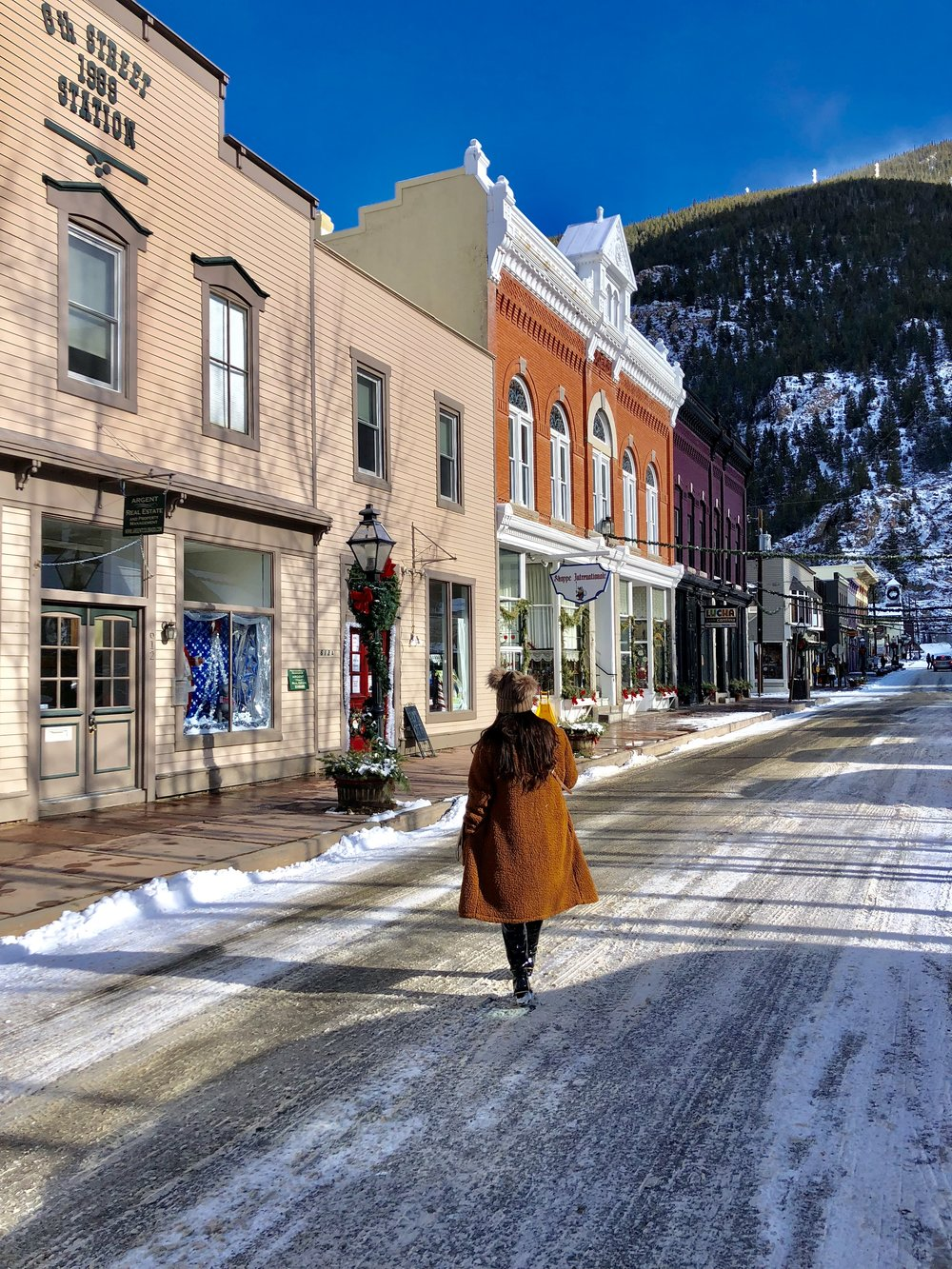 """GEORGETOWN - Georgetown had to be the cutest and the most scenic """"ghost"""" town throughout our Colorado trip. The historic mining town has charming quaint shops and restaurants while overlooking the mountain while walking through the historic village."""