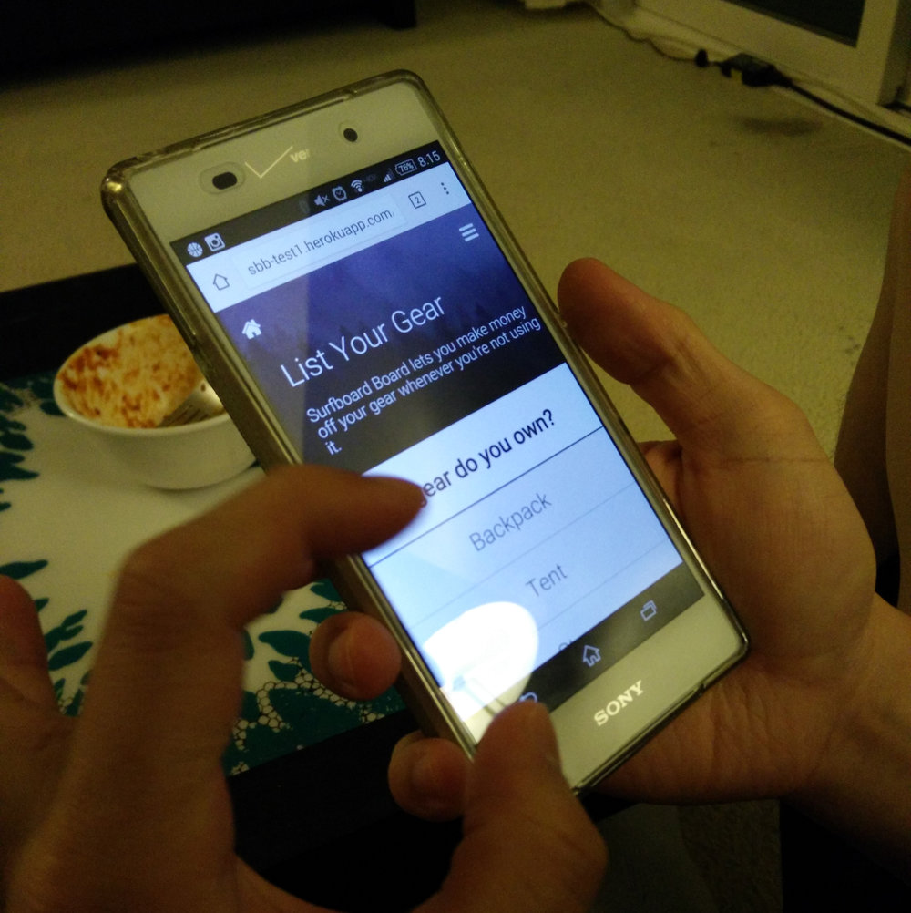 User testing out our mobile prototype.