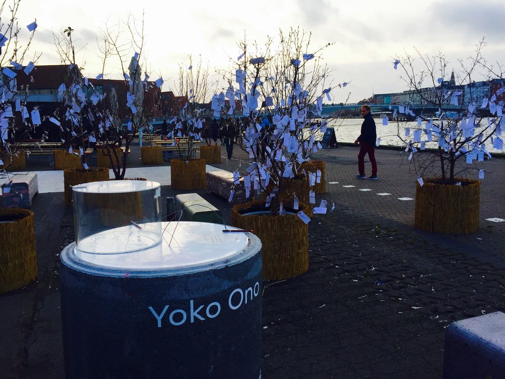 Yoko Ono held an art exhibit right outside Paper Island. Visitors wrote their one wish on little pieces of paper and hung them on trees.