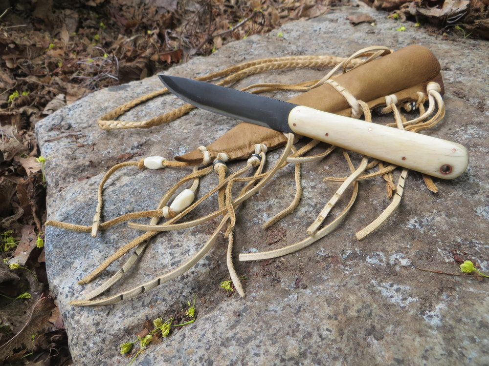 Wild Ass Bone Knife with deer skin sheath decorated.