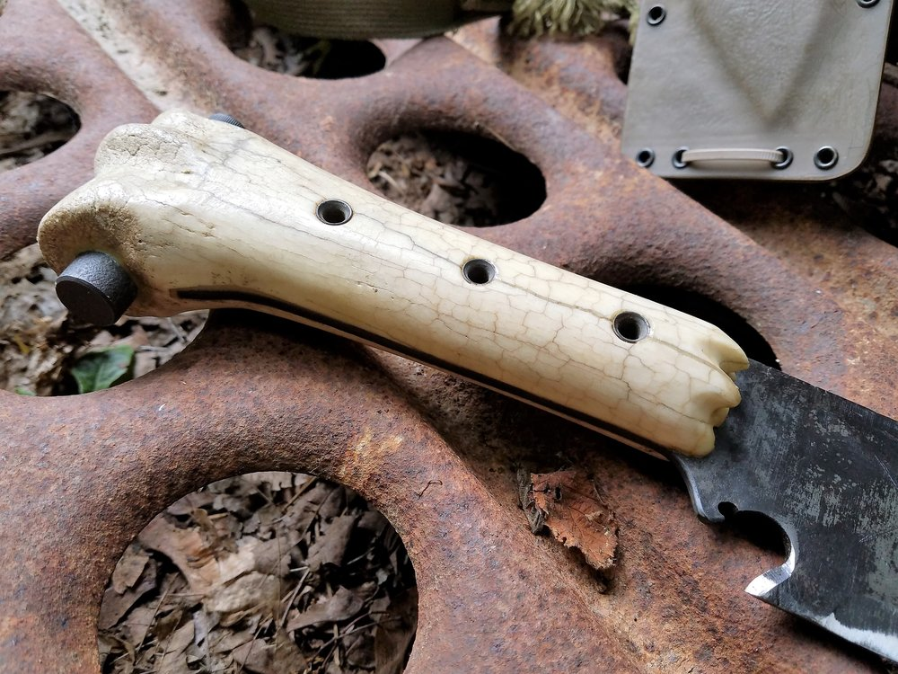 Found cow bone handle with steel tubular rivets.