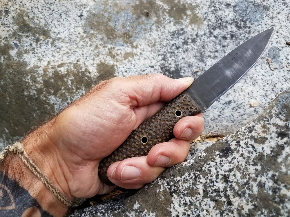 Forged knife with micarta grips.jpg