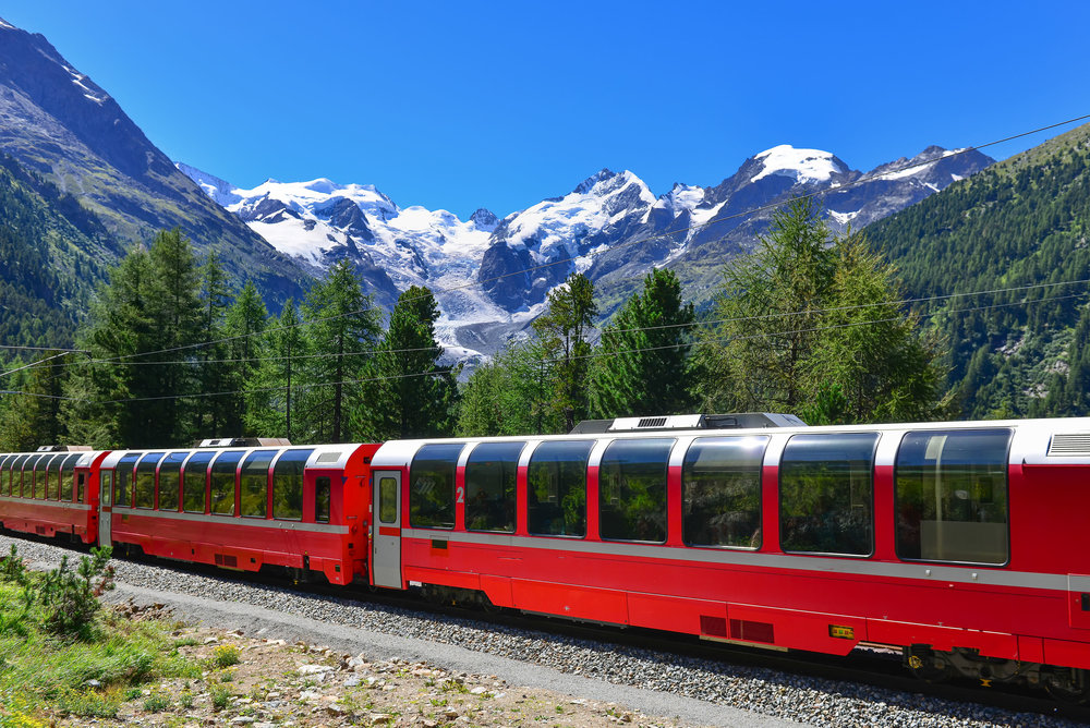 64502496 - swiss mountain train bernina express crossed alps with glaciers in the backgroundin the summer