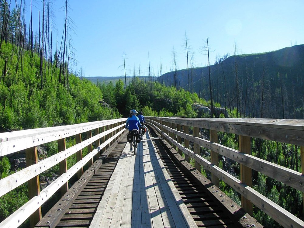 Biking across one of the trestles at Myra Canyon.