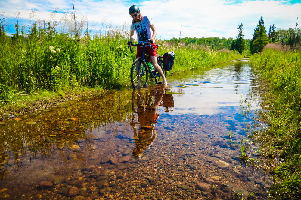 Wet feet are inevitable on this section of the K&P Trail.