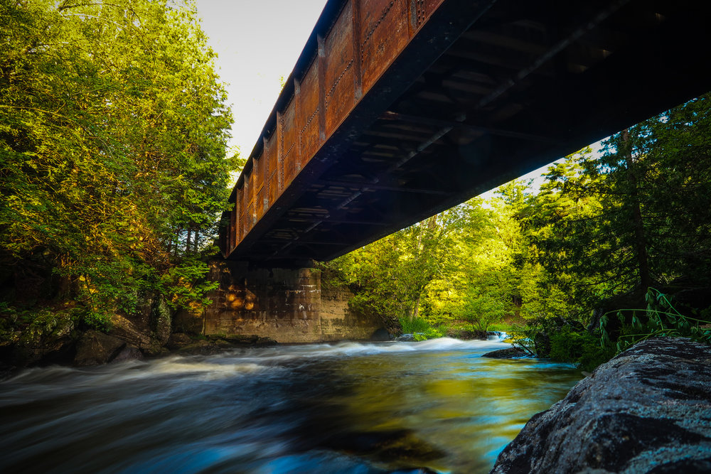 This old bridge along the Trans-Canada Trail crosses the Salmon River near Arden, Ontario.