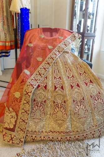 What She Wore:    Natasha wore a beautiful red Lehenga embroidered with   lavish gold threads in intricate designs. The color white (in Indian culture) symbolizes a time of mourning. However, red symbolizes happiness and good fortune