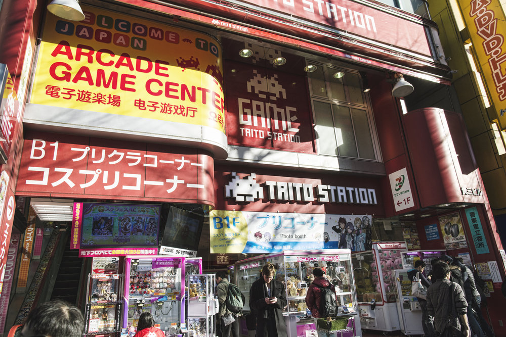 Ando stopped at multiple arcades filled with 6+ stories of arcade games, claw games, quarter machines, and racing sims.