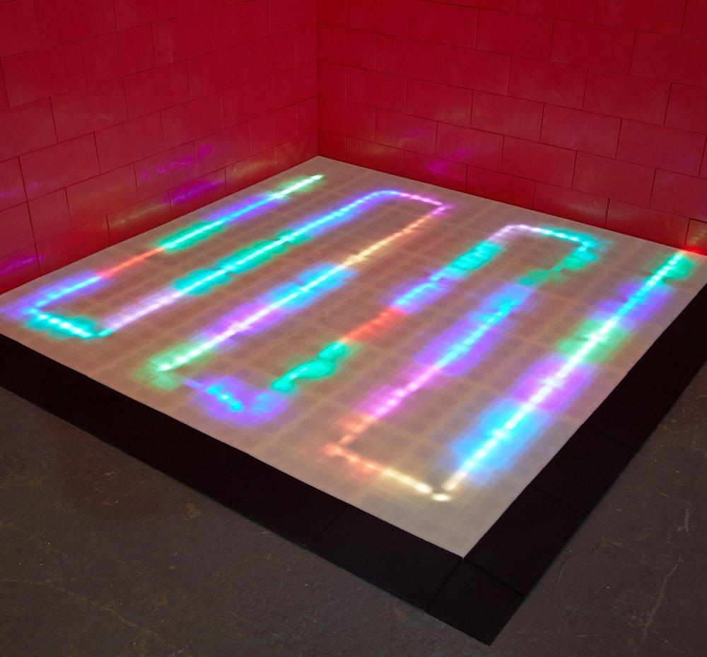 Illuminated trade show floor exhibit floor