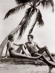 h-armstrong-roberts-smiling-couple-man-woman-under-palm-tree-bathing-suits-florida_u-l-q10bpyx0.jpg