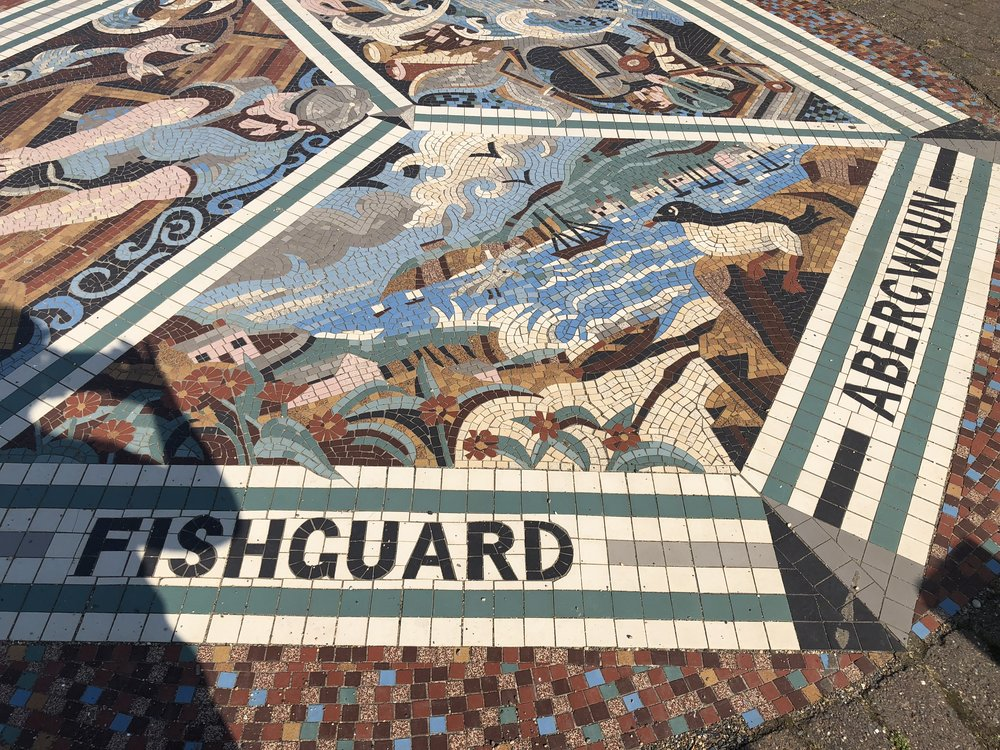 Part of a mosaic by the beach.