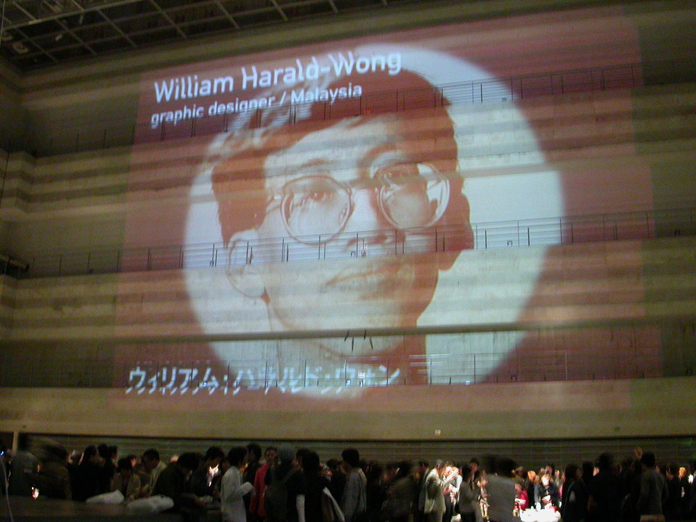 Portraits of key presenters at  Visualogue , Icograda International Design Congress 2003, were projected on the interior wall of the Nagoya Congress Centre, Japan. William led The Design Alliance Asia to a three-and-a-half-hour presentation,  AsiaBeat—A Clash of Signs and Symbols,  covering visual ideas from ten Asian countries.