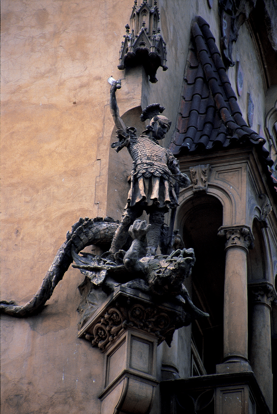 St. George slaying the dragon. In Christianity, the serpent is often associated with the Devil, and the religion promoted the symbolism of saviour-versus-serpent. (Welsh folklore contains some notable exceptions to this view). Photo: Prague, Czech Republic