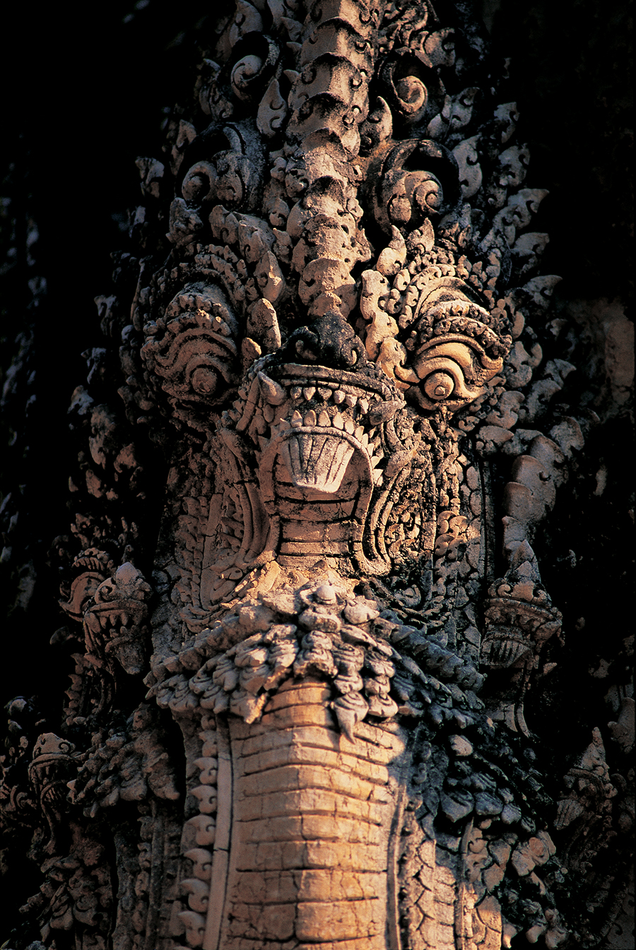 Whether it's Hindu or Buddhist, nagas are found on lintels, form balustrades, and featured above every entry in ancient temples throughout Thailand and Cambodia.  Photo: Sukhothai, Thailand