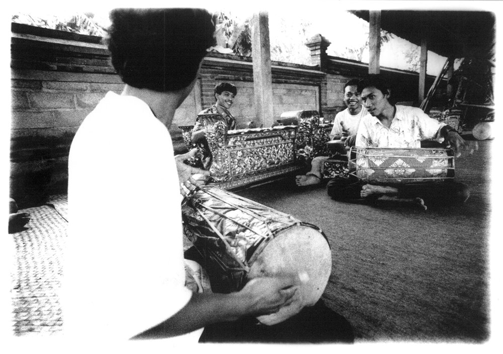 Rehearsals by the gamelan troupe, Semara Ratih. Earlier, the group had commissioned the construction of a special gamelan set called  gamelan semaradhana  (only the second of its kind then), designed to allow the performance of several different genres of music on a single gamelan set: four-tone  angklung , five-tone gong  kebyar , and seven-tone modulating  semar pegulingan . 1994.  Photo: Tara Sosrowardoyo / Collection of Asri Ghafar