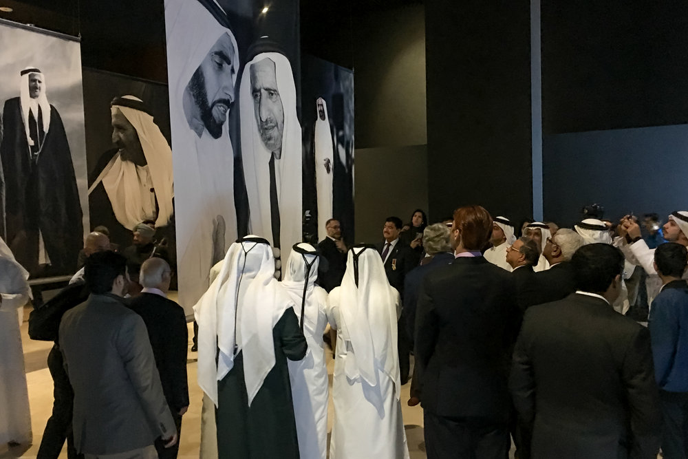 Photographs of Sheikh Zayed and Sheikh Rashid were printed on large translucent banners hung from the ceiling, creating a monumental perspective that reflected their grand vision that transformed simple desert dwellings into the international cities of UAE today.