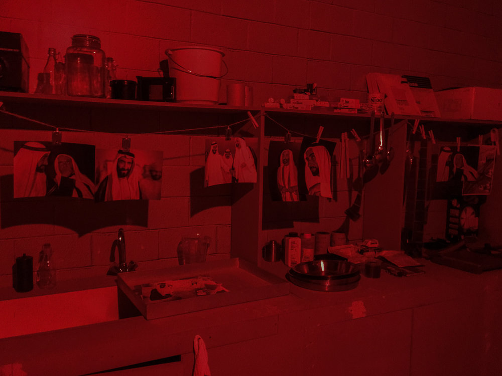 The mock-up darkroom. What's missing was the pungent smell of the film and print processing chemicals. We recorded the sound of prints sloshing in the chemicals, etc, and some small talk in Hindi in the background to bring life into the darkroom space.