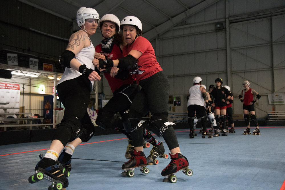 Break Neck Betties jammer ThunderDame tries to push past blockers during a practice drill on Feb. 21, 2017. Portland's Fire Marshal has declared the Oaks Park Hangar where 17 RCR teams practice and compete, unsafe. The league needs to install a costly sprinkler system, limit attendance at games, or find new venue by July 2018.