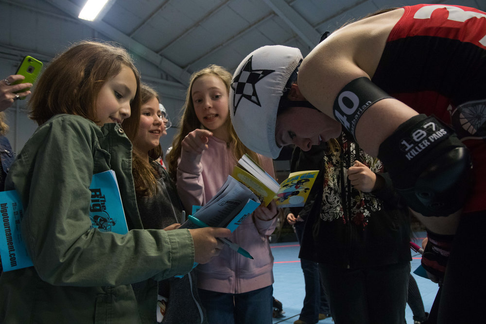 Ovarian Barbarian signs autographs for young fans on April 8, 2017. Many girls look up to the Betties as role models.