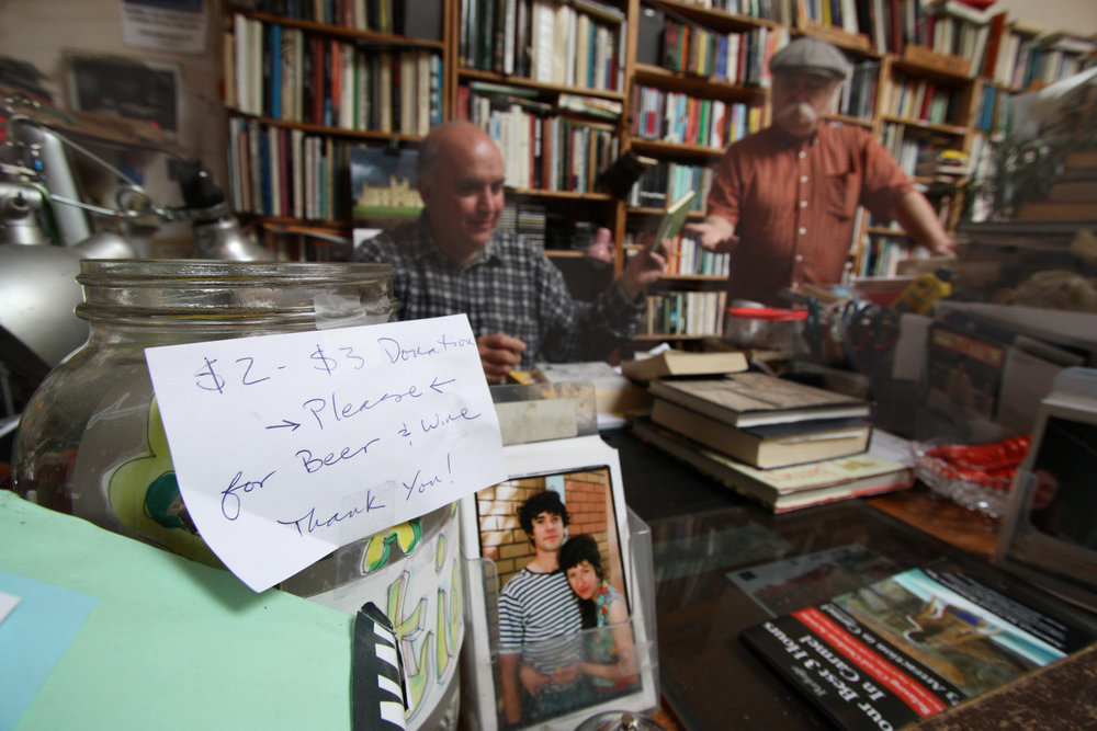 Andrew McKinley (left) and Charlie (right) price books as the day begins, Wednesday April 11, 2012.There are always used books coming in that need to be priced and shelved, so this is a common morning activity.Charlie is not an employee, but helps out at the store on occasion.
