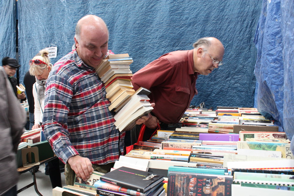 McKinley selects books at the monthly sale held by Friends of San Francisco Public Library.He left with more than 120 used books purchased for $1 each.He declared it a very good day because he typically finds about 40 books at this sale.McKinley scours Bay Area book sales and estate sales to fill the store's shelves.