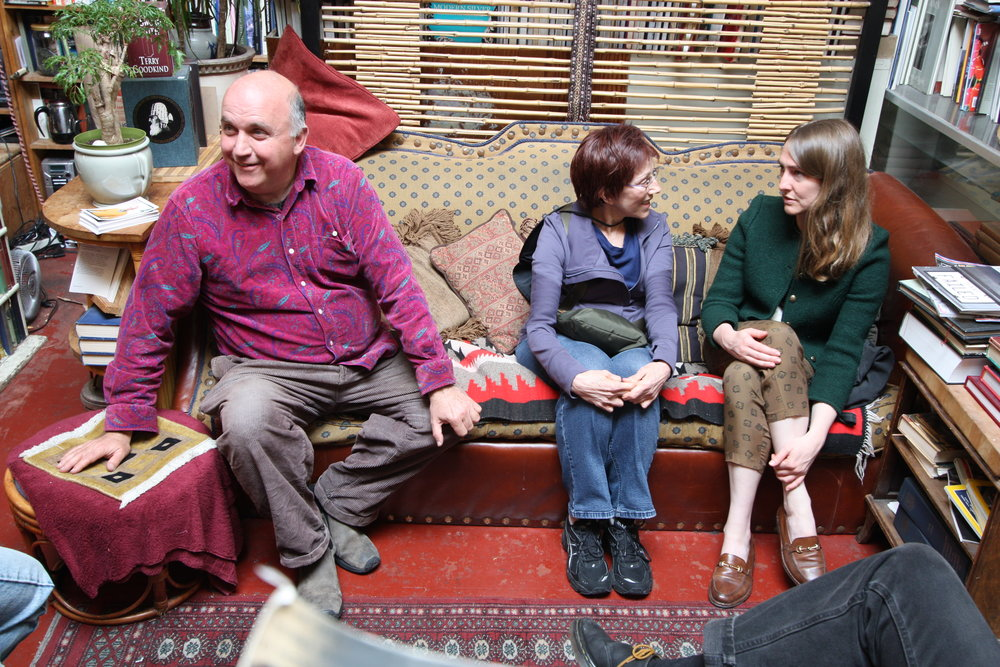 McKinley (left) talks to a friend (not pictured) while new customer, Katie (center) chats with Sara Coenem (right) at Adobe Books. Coenem, a friend of McKinley's, stopped in to say hello after returning from an International trip, while Katie said she'd only recently discovered Adobe and it's quickly become a favorite destination.