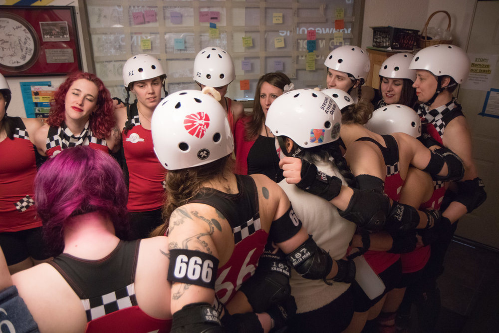 The Break Neck Betties, one of the RCR competitive teams, gather for a pre-game meeting and meditation led by Coach Ripley on April 8, 2017.
